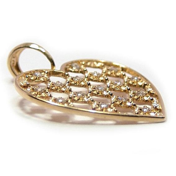 1630696720250 Coração em ouro 18k com zirconias. Zirconia. Características do Pingente